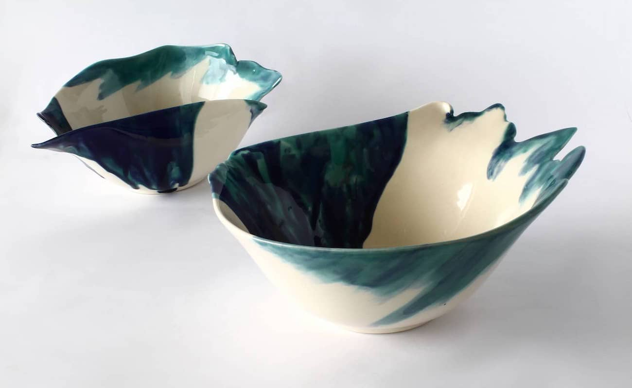 Out of the Blue, Ceramic bowl installation, white and different shades of blue with deformed shapes